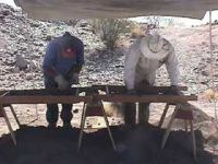 Archeologists screen soil along the Santa Cruz River looking for historic artifacts prior to drilling operations.