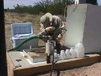 Sampling groundwater from a monitor well installed at the Broadway South Landfill.