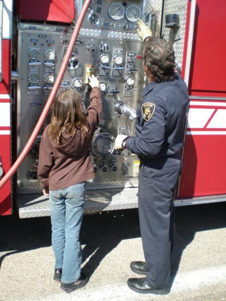 Engine 17 at Adopt-A-School - students get to see the engine and tools up close, learning about what it takes to be a firefighter.