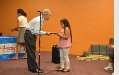 Handing out certificates to participants who completed my Summer Reading Challenge.