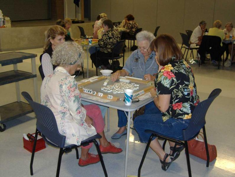 seniors playing board game