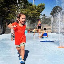 Picture of a child playing at a splash pad.